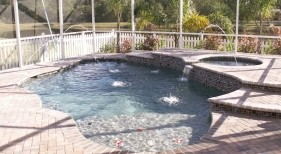 107 - Freeform Pool and Spa with Sunshelf and Deck Jets