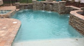 257 - Freeform Pool with Raised Wall and Spa