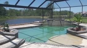 437 - Freeform Pool with Sunshelf and Raised Spa
