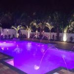Geometric pool with deck jets and LED lights