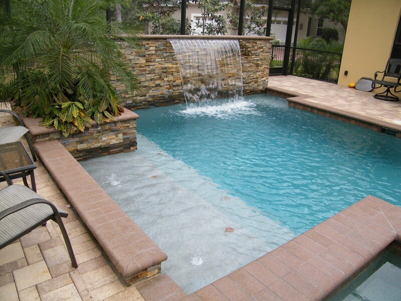 Stacked rock wall, pool bench and tanning ledge