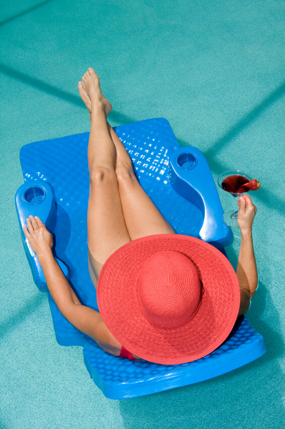 woman lounging sunhat